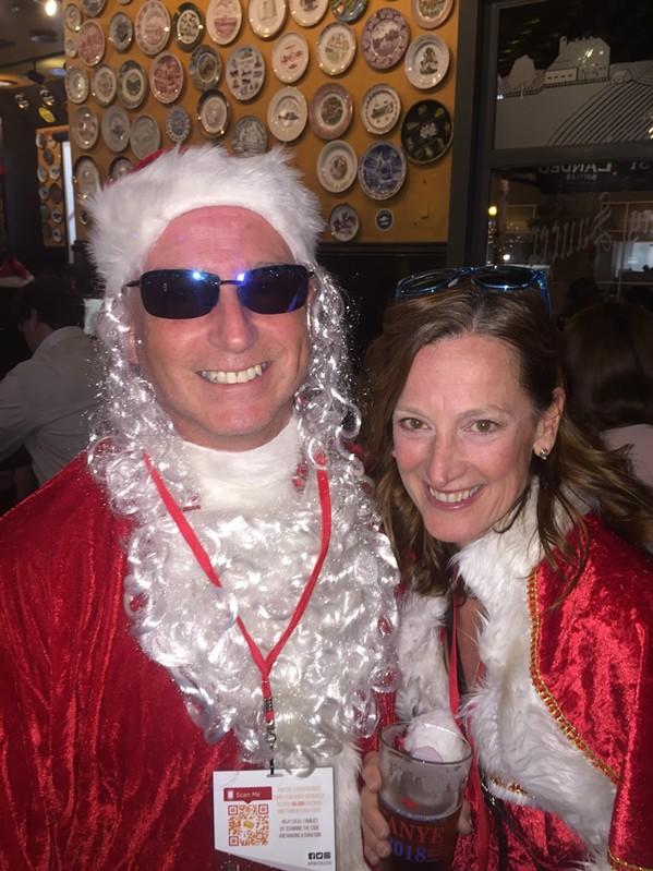 Bob Wilhelm and Carolyn Rock at Stumbling Santa - MICHAEL DONAHUE