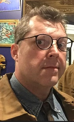 """There's no good way to illustrate these stories but posts without images generate less clicks and """"the need to establish consistent expectations about content pushes news outlets to cover stories in predictable ways and to use personalities as a way to build brand recognition."""" So here's a picture of me in front of weird paintings of fish. I'm sorry."""