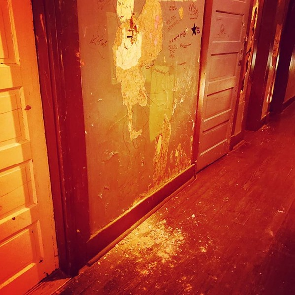 A vandal punched three holes in the wall Saturday night. - EARNESTINE & HAZEL'S/FACEBOOK