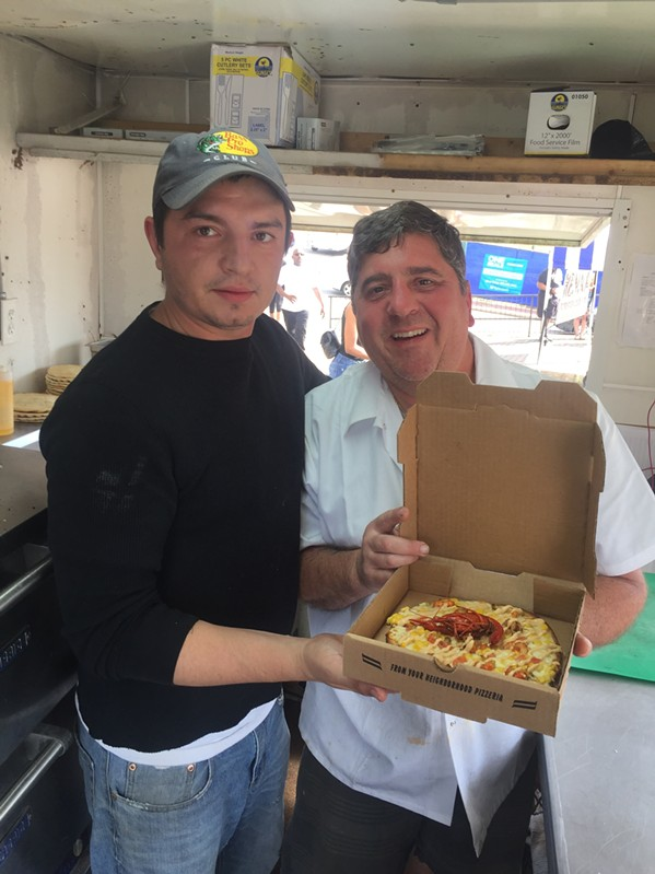 Igor Kobas and Alex Grisanti with a freshly-baked crawfish pizza. - MICHAEL DONAHUE