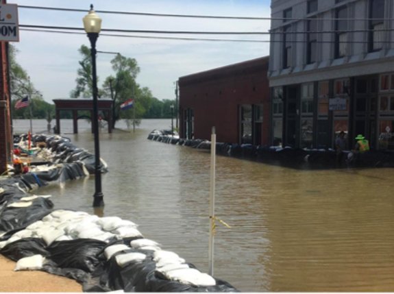 Clarksville, Missouri uses temporary flood structures to save their downtown as the Mississippi River moves up Main Street. - MISSISSIPPI RIVER CITIES & TOWNS INITIATIVE