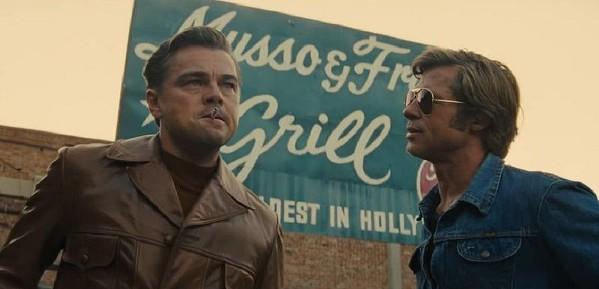 Leonardo Dicaprio as Rick Dalton and Brad Pitt as Cliff Booth