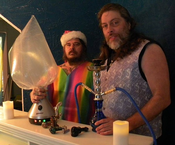 Leo AwGoWhat (left) and Thorne Peters (right) in an undated photo showing the two with a vaporizer, hookah, and glass pipes. - THORNE PETERS/THORNEPETERS.COM