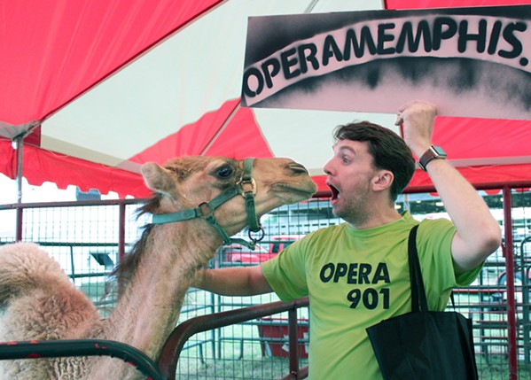 Jordan Wells lights up a camel at a past 30 Days of Opera event at the West Tennessee State Fair. - JILLIAN BARRON