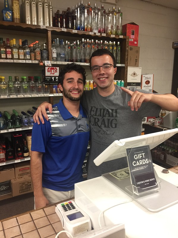 Grant Slattery and Alex Espinosa on Slattery's last day Wine Depot. - MICHAEL DONAHUE