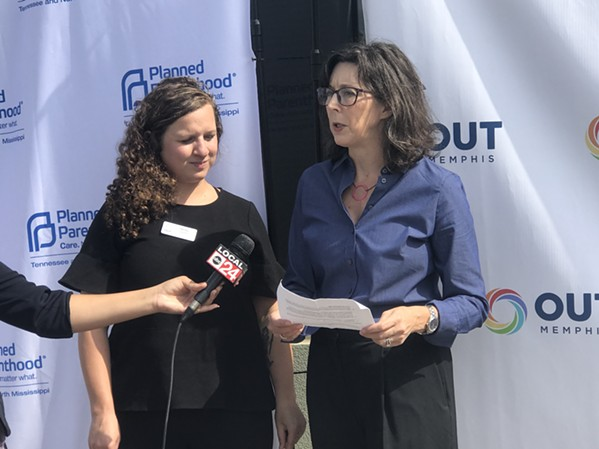 Molly Quinn, OUTMemphis executive director (left), and Ashley Coffield, PPTNM president (right), speak during a news conference in front of OUTMemphis' new administrative office building. - TOBY SELLS