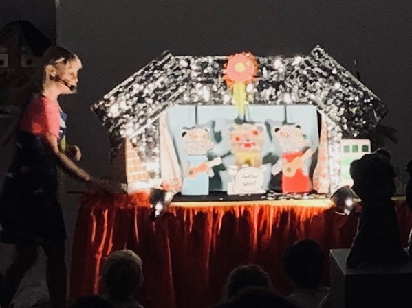 """Miss Pussycat presenting her """"History of Egypt"""" puppet show, featuring Guitar Wolf as it segued into a """"History of Gonerfest""""."""