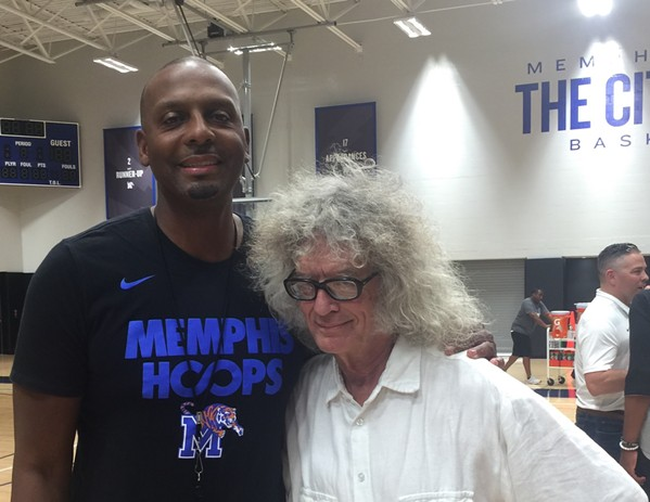 I still feel like I'm going to get in trouble walking on the gym floor in hard-soled shoes instead of athletic shoes, but I, along with some 500 fans, couldn't resist getting their photo taken with Penny Hardaway on the court at a Memphis Rebounders event at the University of Memphis. - HAROLD BYRD