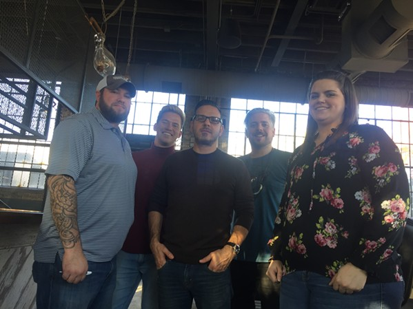 General manager Billy Williams, Eric Bourgeois, Aldo Dean, operations director Bobby Heath, assistant manager Chelle Morgan at Slider Inn-South Main. - MICHAEL DONAHUE