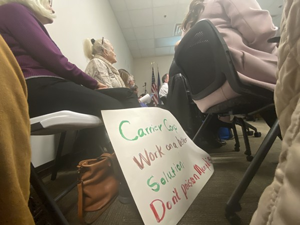 """A protest sign from Kathleen Meier reads: """"Carrier Corp. work on a better solution. Don't poison Memphis."""" - TOBY SELLS"""