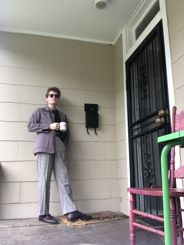Max Kaplan relaxes with a cup of coffee on Harbert House porch. - MAX KAPLAN SELFIE
