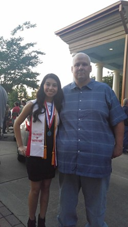 Poole and her dad on the day she graduated high school - POOLE
