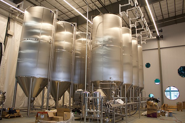 Towering tanks will allow Wiseacre to ramp up production. - WISEACRE BREWING CO.