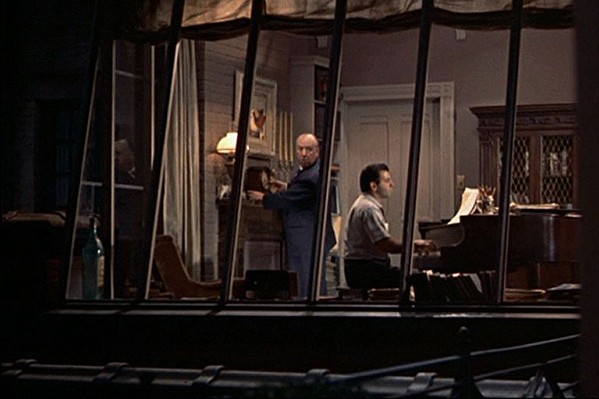 Alfred Hitchcock's cameo in Rear Window.