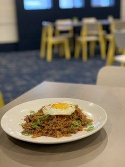 SOB's duck fried rice, complete with egg on top, is one of the restaurant's most popular items. - MURRAY LACE/OBSIDIAN