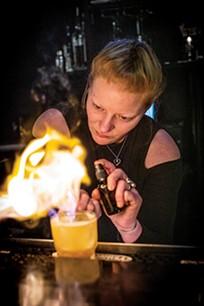 Cady Smith with a blazing cocktail - JUSTIN FOX BURKS