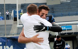 Ryan Silverfield and Brady White embrace on Senior Day. - JOE MURPHY
