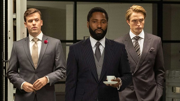 John David Washington (center) and Robert Pattinson (right) are impeccably dressed secret time agents in Tenet.