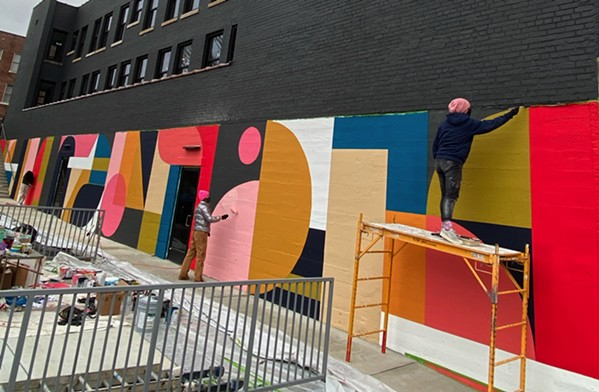 Erin Miller Wray working on her mural on the side of the Ambassador Hotel, which is the future home of South of Beale gastropub. - WHITNEY WILLIAMS