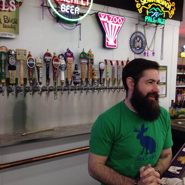 Taylor James at the Madison Growler filling station in 2014. - MADISON GROWLER AND BOTTLE SHOP/FACEBOOK