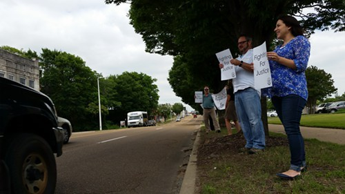 Employees stand outside The Commercial Appeal building on Union Avenue.