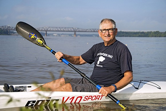 Outdoors Inc. owner Joe Royer paddles the Mississippi nearly every day
