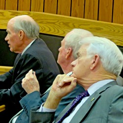 Kennedy and Luttrell (r) listen as CFO Swift makes administraton case. - JB
