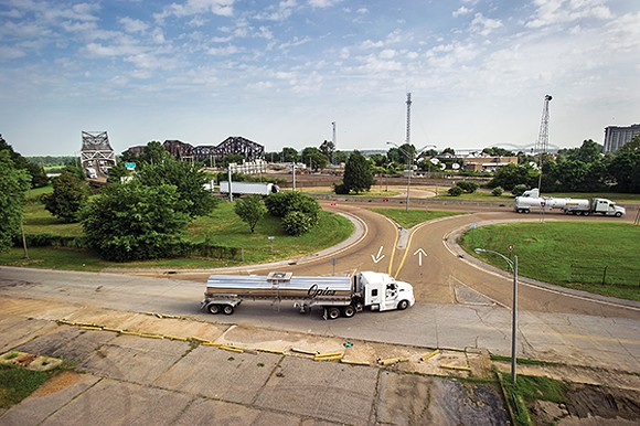 Trucks enter the current cloverleaf ramp to I-55, where interstate traffic must slow to 25 miles per hour - BRANDON DILL