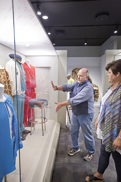 John Doyle, executive director of the Memphis Music Hall of Fame, discusses the layout of a large case with Pam Parham, director of operations. - JUSTIN FOX BURKS