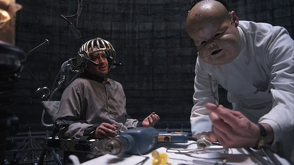 Pryce and Michael Palin as Jack Lint in Brazil's climactic torture scene.