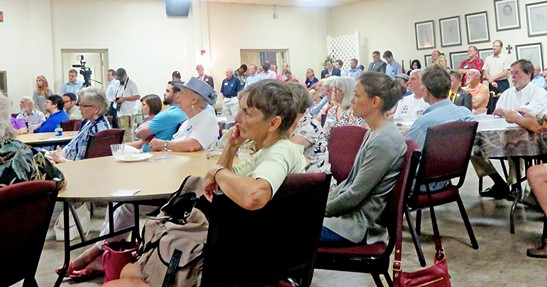 The spectators for the 5th District City Council debate filled the room and lined the walls at  Trinity United Methodist Church., - JB