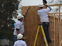 Memphis Mayor-elect Jim Strickland (l) volunteered his home-building efforts on Monday. - HABITAT FOR HUMANITY