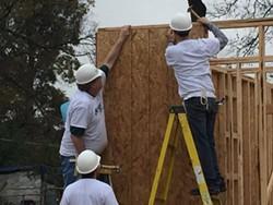 Memphis Mayor-elect Jim Strickland (l) volunteered his home-building efforts on Monday. - HABITAT FOR HUMANITY