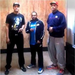 ( lto r) Isaiah Stokes, trainer Jevonte Holmes, Jarnell Stokes. - JAMIE GRIFFIN