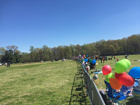 A photo of last Saturday's Greensward protest, during which the Memphis Zoo erected a fence to keep protesters away from the area where they planned to park cars. - TOBY SELLS