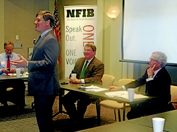 """State Senator Brian Kelsey (standing) took his turn addressing local NFIB members on Wednesday, while state Senator Mark Norris and state Representative Mark White waited their turn. At left is state NFIB director Jim Brown, who moderated the """"State Issues Roundtable."""" - JB"""
