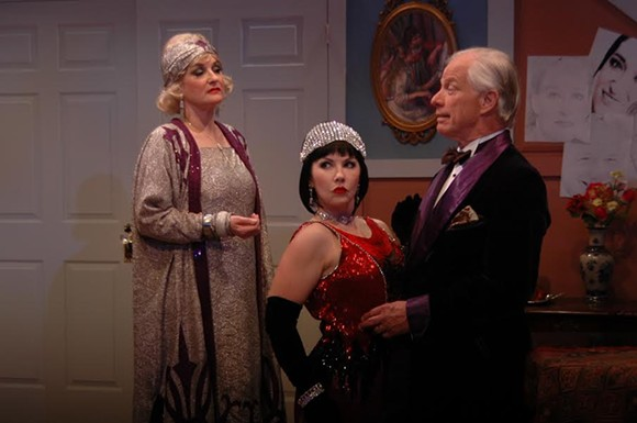 Christina Wellford Scott (l) portrays the matriarch of the over-the-top literary, artful and theatrical Bliss family and discovers shenanigans between her husband, played by Greg Fletcher (r) and a weekend guest, played by Melissa Walker in Noel Coward's comedy Hay Fever at Theatre Memphis on the Lohrey Stage, April 29 - May 15, 2016.