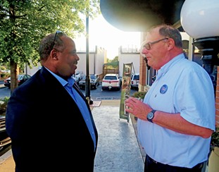 Shelby County Democratic Party chairman Michael Pope (left) with Germantown Democratic Club president Dave Cambron at a party fundraiser on Thursday - JB