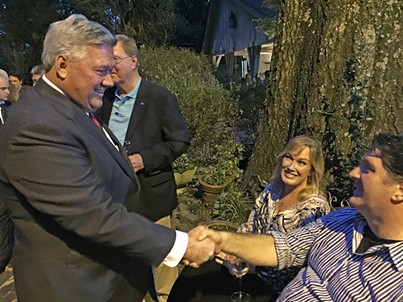 Nashville Democrat Bill Freeman, a potential gubernatorial candidate, greets David Upton and Kathy Ferguson at last week's GOTV event and Lee Harris fundraiser. - JB
