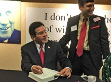 """Gonzales signing copies of memoir, """"True Faith and Allegiance,"""" for Republicans at Lincoln Day - JB"""