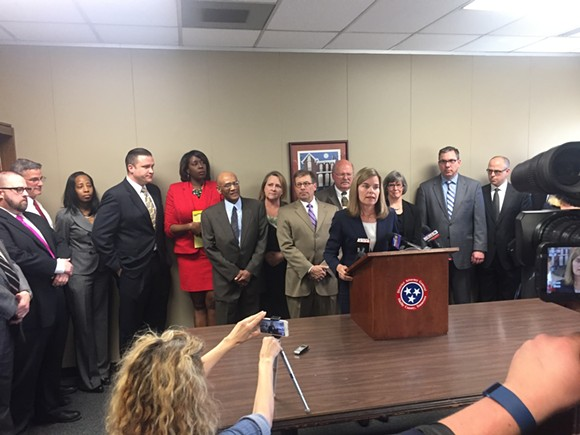 Amy Weirich and members of her staff during a news conference Monday. - TOBY SELLS