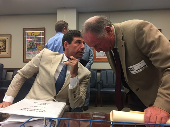 Council member Reid Hedgepeth confers with Memphis Zoo president Chuck Brady after a contentious committee meeting on the zoo parking project. - TOBY SELLS