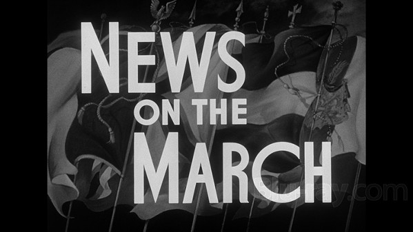 Title card from the newsreel sequence.