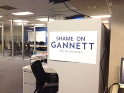 """The Guild hung """"shame on Gannett"""" posters around the office at the newspaper's headquarters at 495 Union. - NEWSPAPER GUILD OF MEMPHIS"""