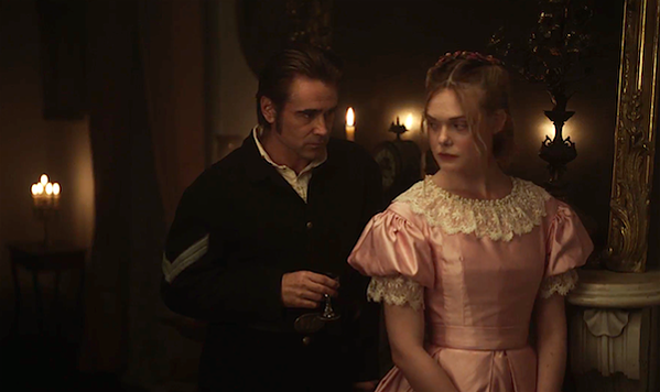 Colin Farrell puts the moves on Elle Fanning.