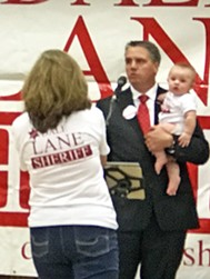 Candidate Lane also gets a boost from wife, Karen, and baby grandson Braxton Allen Lane. - JB