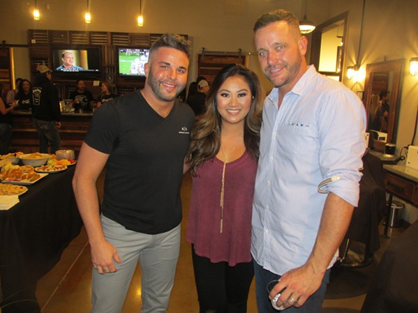 Matthew Thacker-Rhodes, Dara Vongphrachanh and Jeremy Thacker-Rhodes at Baron's Man Cave party. - MICHAEL DONAHUE