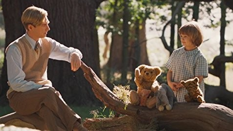 Will Tilson (left) as Christopher Robin, along with the stuffed  inspiration for Winnie the Pooh and friends.