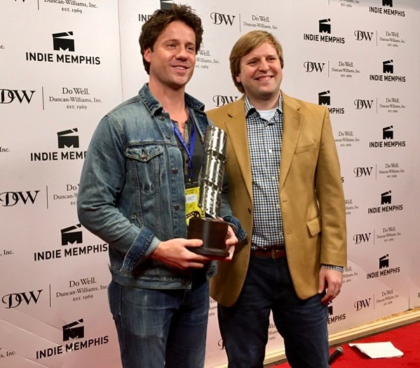 Hometowner Narrative Short Audience Award Winner Nathan Ross Murphy receives his trophy from Indie Memphis' Ryan Watt.