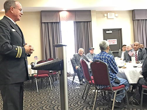 County Commissioner Terry Roland (seated, left) and state Senator Lee Harris (seated, right, behind flag on table), candidates for County Mayor and co-sponsors of an annual  Veterans Town Hall and Luncheon in Millington, listen as Millington Mayor Terry Jones, dressed in his Naval reservist's uniform, speaks to the occasion. - JB